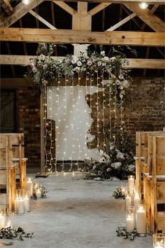 rustic wooden benches and floral fairy light backdrop, candle aisle decorations