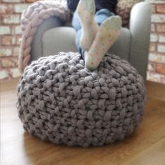 Chunky knitted footstools that are filled with bean bag beans, kids seem to enjoy diving onto them which is always fun, as well as their primary purpose of being a comfortable footstool and seat :D