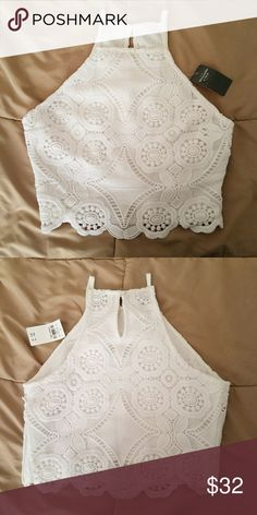 NWT Abercrombie Lace Cropped Halter Top White crop top with zipper on left side. Please note that this top has been altered and was originally a size small and will now fit an extra small better (fits snug around the bust but still a little loose and flowy around my waist). Abercrombie & Fitch Tops Crop Tops