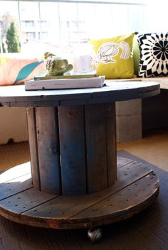 An industrial cable spool / spindle is repurposed into a handy coffee table