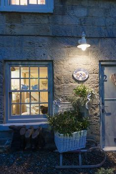 Blue Trim with the Stone building. Gorgeous! Wouldn't you just love to stay here? So inviting.