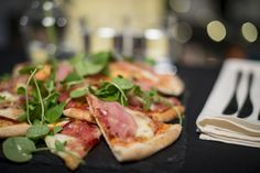 Evening buffet wedding idea - rustic stone-baked pizzas