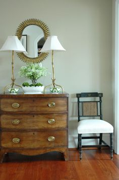 Morrison Fairfax Interiors: Modern cottage foyer with vintage chest with brass hardware and black vintage foyer ...