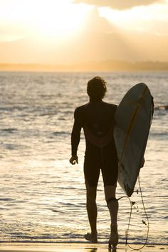 Heading out for a sunset surf at the Pass.