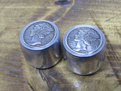 Silver toned Indian penny guitar knobs with knurled sides.