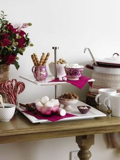 Put out a pot of sweet, steamy cocoa, then invite company to add their favorite fixings. Mix spray roses, real or faux winter berries and boxwood for a wintry arrangement.