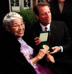Rosa Parks Photo Gallery: Rosa Parks showing off her Congressional Gold Medal of Honor with US Vice President Gore prior to a benefit tribute concert in Mrs. Parks' honor. 1999 (Photo: EPA)