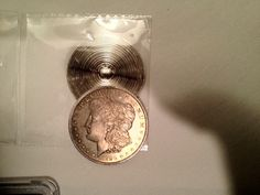 An example of a Morgan Dollar cut in half to match a date with a mintmark to have the coin appear something it is not. Coin was in a counterfeit PCGS slab and caught by one of their graders. Coins, Personalized Items, Silver, Gold, Rooms, Yellow, Money