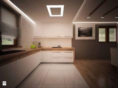 Podwieszany sufit nad kuchnią z fajnym wbudowanym oświetleniem