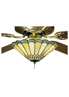 12 Inch W Jadestone Carousel Fan Light Fixture. 12 Inch W Jadestone Carousel Fan Light FixtureThinly carved and polished natural Jadestone in earthy tones of Moss Green, Tan, and Coral, becomeluminescent in this charming scalloped edged shade. Thestone shade is crafted with the same copper foil processthat is used on stained glass, Tiffany style shades.Fan not included. Theme:   Product Family:  Jadestone Carousel Product Type:  CEILING FIXTURE Product Application:  FANLIGHT SHADES Color:...