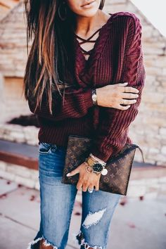 Burgundy laced front sweater with blue jeans.