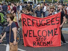 Germans stage pro-migrant rally with 'refugees welcome' banners in response to violence - Europe - World - The Independent