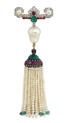 AN ART DECO PEARL, RUBY, EMERALD AND DIAMOND TASSEL BROOCH, BY CARTIER. The old-cut diamond-set bar surmount with single button-shaped pearl terminals, central emerald and ruby highlights, suspending an inverted baroque shaped pearl spacer and pearl tassel drop, with emerald bead finials, ruby and rose-cut diamond-set cap, 1920s, 11.8 cm, with French assay marks for platinum and gold. Signed Cartier Paris, numbered.