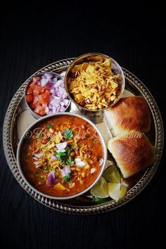 "Misal Pav | Misal means ""mixture"" in Marathi and if you are in Mumbai, you definitely should not miss this treat! Technically, a usal topped with farsan/Mix Namkeen, chopped onions and lemon, it is best served with Pav."