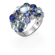 Shanghai ring in 18kt white gold with iolites, blue sapphires, blue topazes and diamonds.by Roberto Coin