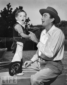 Peck and his son Jonathan in their yard at home, 1946. {Aww, this is just adorable.}