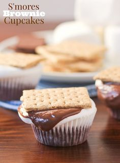 S'mores Brownie Cupcakes recipe.  Make your very own s'mores in the kitchen with this simple S'mores Brownie Cupcakes. Campfire Giant Roaster Marshmallows fit perfectly on top of the brownies. Just add chocolate and a graham cracker — the gooey, chocolatey treat is perfect.
