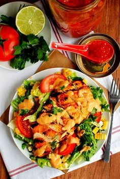 Chipotle Mango BBQ Chicken Salad (Homemade Chipotle Mango BBQ Sauce, Chicken Breasts, Shredded Romaine, Corn on the Cob, Tomatoes, Parsley, Dressing (Chipotle Mango BBQ Sauce Mixed with Greek Yogurt and Lime))