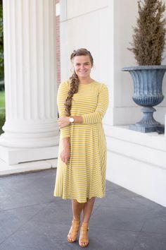 Mustard-and-White-Striped swing dress by Dainty Jewell's Modest Apparel. Modest fashion, bridesmaid dresses, ruffles, lace, girls' and plus sizes. www.daintyjewells.com