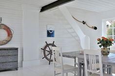 white coastal dining with vintage nautical decor