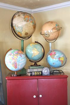 globes, books, and a clock...love the combination. Perfect for my map obsession!