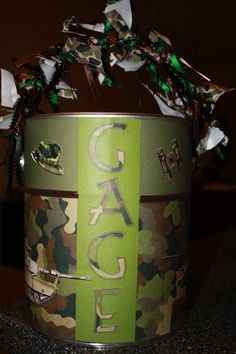 camo paint can~ we could make with Mossy oak and pink... cute for grad.party