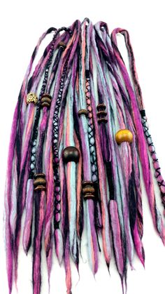 10 one of a kind, multi coloured purple and black woolen dread lock hair extensions. Hand made with Australian Merino wool (and lots of love) and adorned with beautiful cottons, wool yarn and wooden beads. These look as amazing in 'normal' hair as in dread locked hair.  A great way to funk up ...