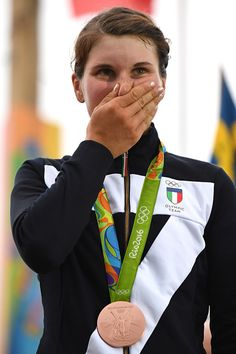 Bronze medallist Italy's Elisa Longo Borghini poses on the podium after the Women's road cycling race at the Rio 2016 Olympic Games in Rio…