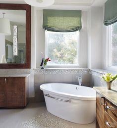 Freestanding tub oriented in corner tub area