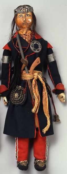 Huron Doll....Lorette-Huron Male Doll, ca. 1830, wood, fabric, glass beads, metal, and hide, The Elizabeth Cole Butler Collection.