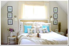 Love the chair beside the bed.     Beach-themed-bedroom-bedrooms-blue-green-lavender-accents2