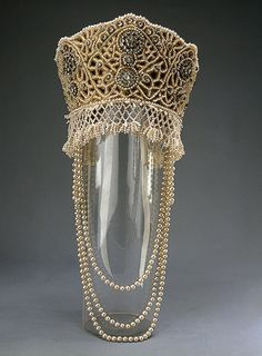 Kokoshnik accessory for a fancy Court ball dress of Princess Elena Golitzine celebrating the Romanov's 300th Dynasty Anniversary, circa 1903.  Made of satin, brocade, lace, fake pearls, rhinestones, sequins, metallic thread;; sewing, embroidery. 14 x 16 cm.