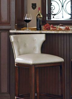 Dress up your bar or island in sophisticated style with the Marseille Bar and Counter Stool; available in four rich colors atop a sturdy hardwood frame and adorned with a classic nailhead trim.