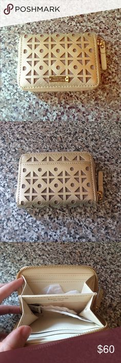 kate spade wallet New used. Gold cut out pattern. Zip close. One outter pocket, four inside slots for credit cards. kate spade Bags Wallets