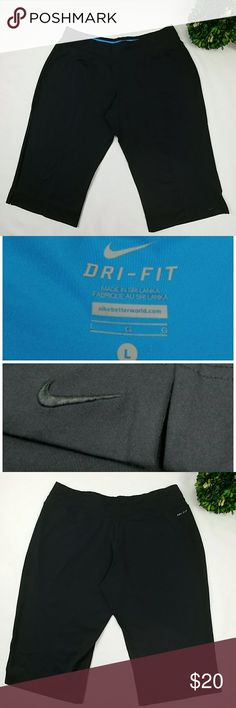 """Nike workout capri pants Nike workout sport capri pants. All black color with blue waist inside. No pockets. Has two little side slits at the knees. In good used condition. There is a loose thread and two tiny holes at the waist from where the tag used to be,you can see in last photo. 92%polyester 8%spandex Size large Waist 16.5"""" laying flat Inseam 18"""" Nike Pants Capris"""