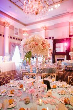 blush white centerpieces in silver candelabra