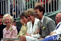 The Princess of Wales with Virginia Wade (second left) and Cliff Richard sharing a joke. (1991)