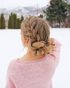 Braided Bun - We love braids. We love buns. Here, two become one. Pull hair straight back and create a loose braid. Wrap into a loose bun and pin to secure. Embellish with flowers or crystals for a special night.