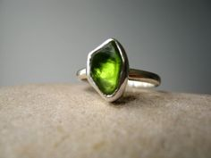 Custom Select your Rough Peridot - Ring in Sterling silver - Tower Ring. $138.00, via Etsy.