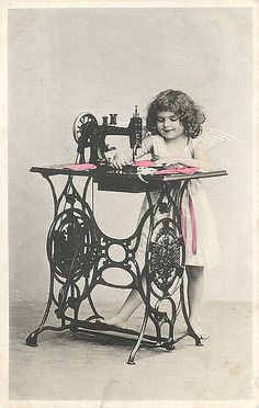1906 Sewing Machine-I love that she looks like she knows how to treadle.
