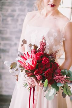 Red bridal bouquet with a protea | Natalia Donskih Photography