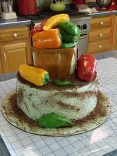 A garden cake! The peppers are rice cereal treats covered in fondant. A treat for the gardener you know! Made by Christina's Cakery.