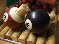 OK...I HAVE MADE THESE Q-BALL WINE CORKS TWO DIFFERENT WAYS...I LIKE THIS WAY THE BEST...MY HUBBY DRILLED A HOLE LARGE ENOUGH FOR THE CORK TO FIT INSIDE THEN SECURE IT WITH SOME GOOD GLUE...GREAT FOR A MAN CAVE WHICH IS WHAT WE USE THEM FOR!!!!!!!