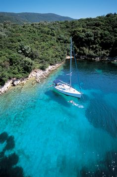 A Beneteau anchored for a lunch stop in the Meganisi channel...