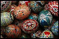 Pysanky - Ukrainian egg decorating using a wax-resist method.  Draw on the egg. everything you want to remain white, cover with wax.  Dip in next darker color (yellow usually).  Then everything you want to remain yellow, cover in wax.  Dip again with darker and darker colors.  Babby and Tuco are too young for these, but not me!