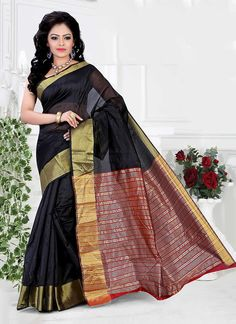 Ravishing attire to enhance your beauty. Make an adorable statement in this smash black cotton   casual saree. The patch border work looks chic and perfect for any occasion. Comes with matching blouse.