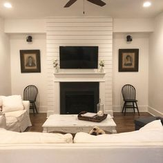 Shiplap fireplace in white living room painted Benjamin Moore Simply White