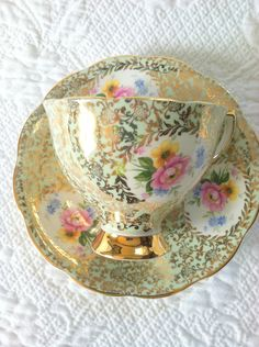 Teacup and Saucer. Highly decorative in flowers and gold