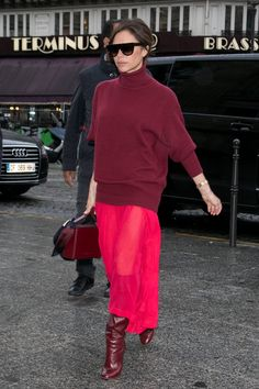 And Swapped the Runway Bag For a Burgundy One to Match Her Outfit