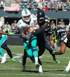 Seattle Seahawks defensive end Frank Clark sacks Miami Dolphins quarterback Ryan…